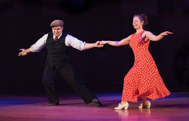 Robert Evans & Julia Box performing lindy hop at a ballroom showcase